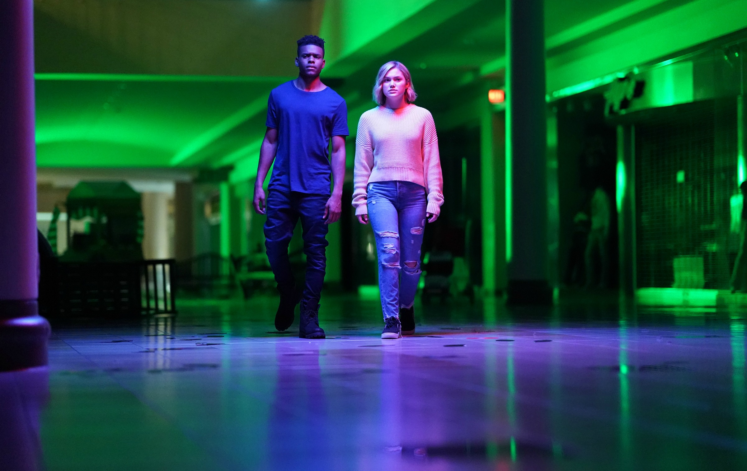 "Tyrone and Tandy walk through the eerily light hallway of the ""mall"" inside the Darkforce Dimension."